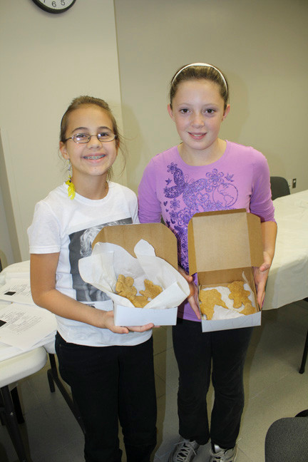 Jessica Corona, left and Olivia Gilmartin showed off their finished dog treats.
