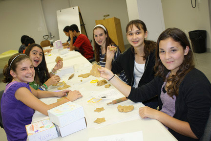 Katie Fay, left, Shona Daly, Kaitlin Costello, Ana Corona, and Tara Podias worked together to make their dog biscuits.