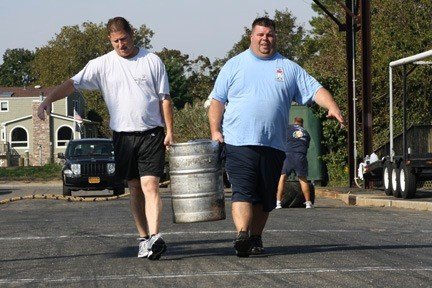Keith Eckels, left, and Kevin Smith now tote kegs for reasons other than personal enjoyment.