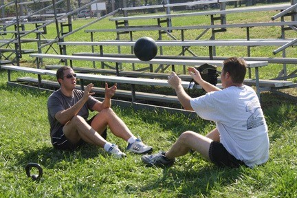 Craig Yanantuono and fellow firefighter Keith Eckels played a heavy game of catch to work their arms and abs.
