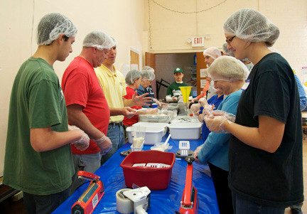 Community volunteers gathered at the Oceanside Lutheran Church to package meals for hungry children in our area.