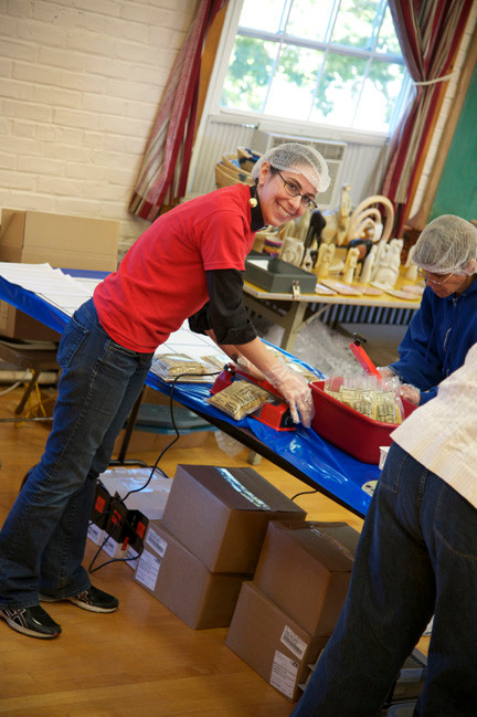 Rev. Danielle Miller helped pack meals at the Oceanside Lutheran Church.