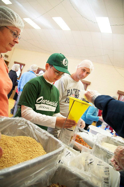Wil Keller, 12, sorted and packaged the pasta for the macaroni and cheese meals.