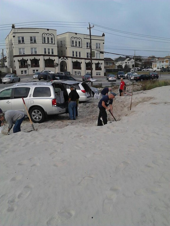 Residents filled sandbags on the beach on Saturday. The city ran out of its supply after it gave away 20,000 sandbags to residents.