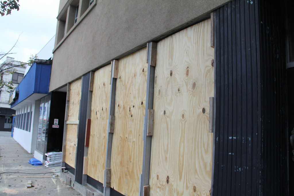 Storefronts in Rockville Centre show the preparations being made for the coming of Hurricane Sandy on MOnday.