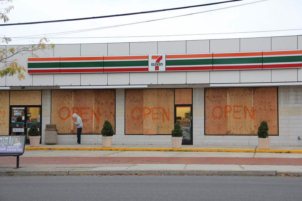 Although the 7-Eleven on Atlantic Avenue in Oceanside was boarded up on Sunday, it was still open for business.