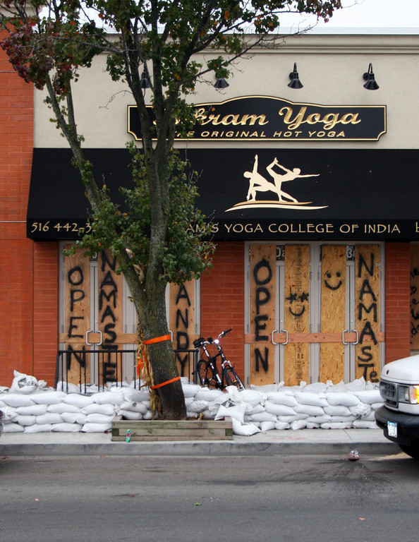 Bikram Yoga on Park Avenue boarded up and put sandbags in front of the business. Officials are expecting significant flooding.