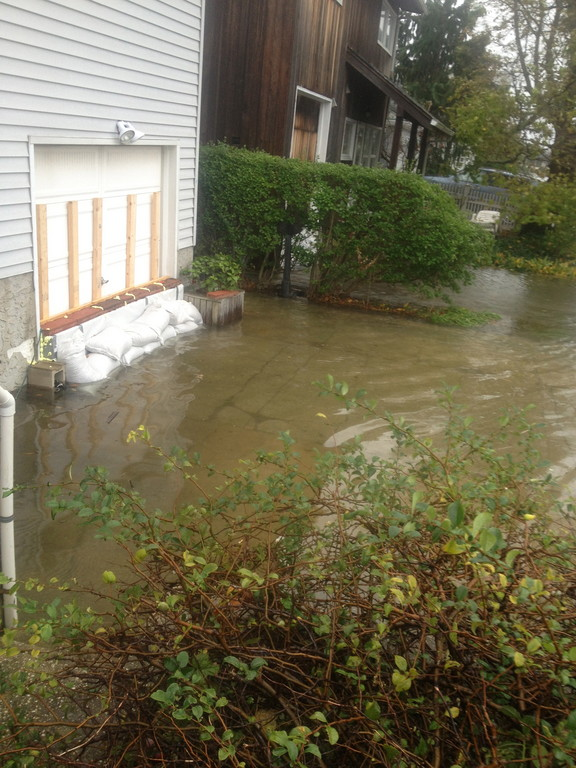 Boyd Street resident Roy Lester constructed a concrete barrier and placed sandbags in front of his home, but said that the flooding is still too much.