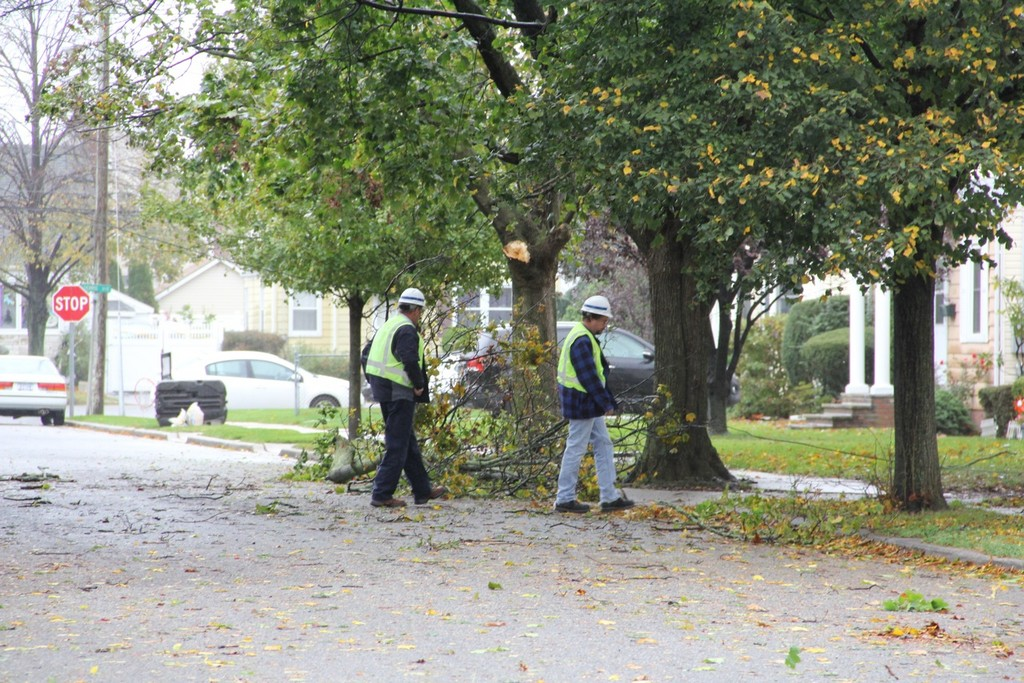 LIPA workers surveyed damage on Frame Street in Franklin Square.