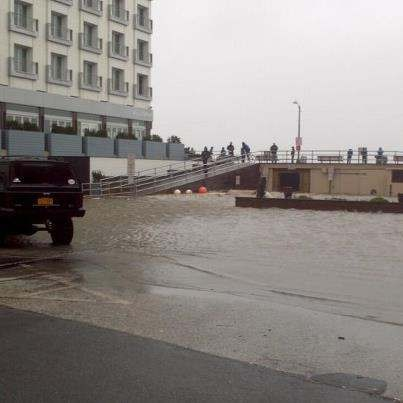 Ocean water has already breached the boardwalk, including National Boulevard near the Allegria Hotel, and is flooding local streets.
