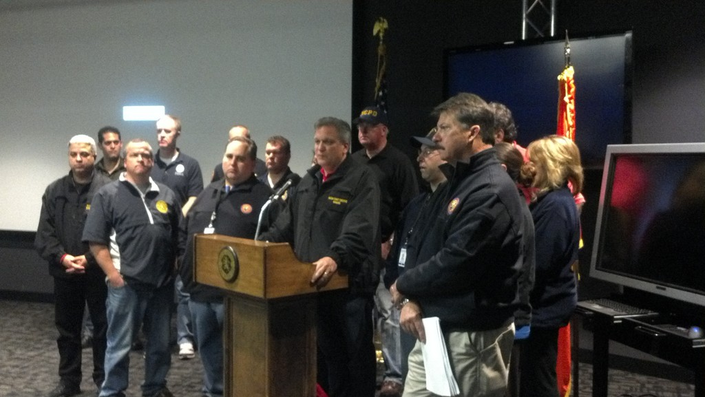 County Executive Edward Mangano, center, along with representatives from every county department and FEMA, addressed the public earlier today from the county's Office of Emergency Management in Bethpage.