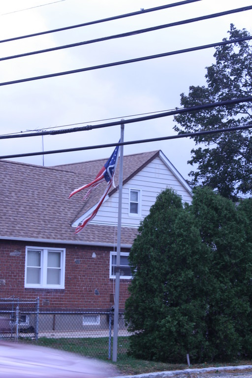 A tattered flag flew in front of a house on Oceanside Road in Oceanside.