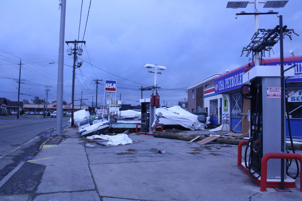 Boats were shoved against the sides of stores on Austin Boulevard in Island Park.