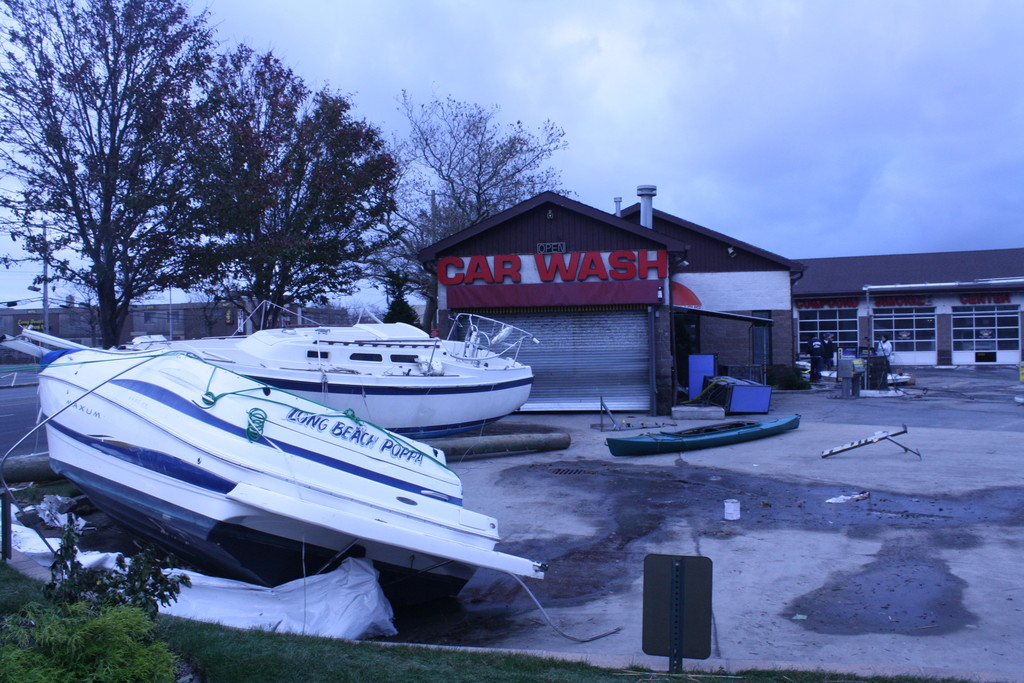 The car wash at the intersection of Austin Boulevard and Long Beach Road was blocked by boats that were washed away from their dock.