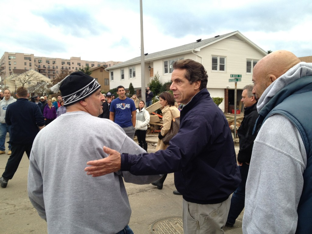 Cuomo shook hands with a Long Beach resident on Wednesday, after Hurricane Sandy left the city in shambles.