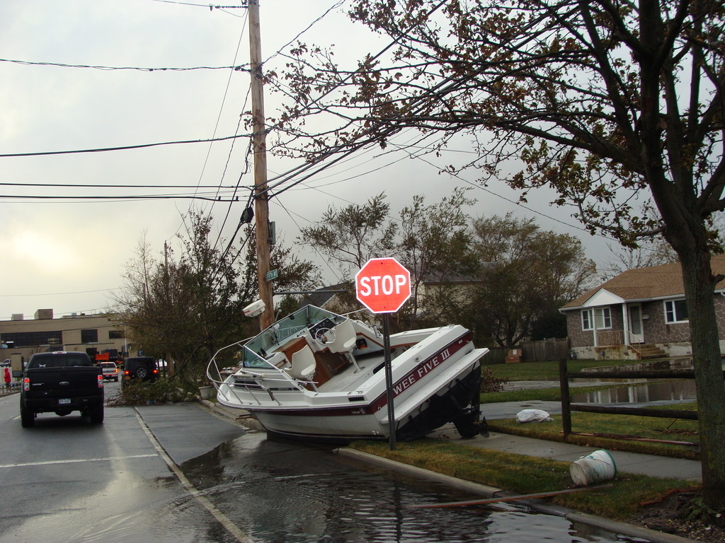 A boat floated down the street to eventually rest in front of a Fifth Avenue home in Bay Park.