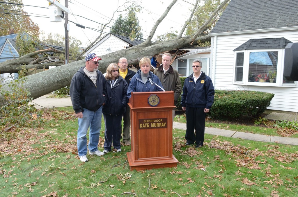Town of Hempstead Supervisor Kate Murray held a press conference on Thursday, Nov. 1 in front of a Levittown home on Rose Lane that was damaged by Hurricane Sandy. Murray, center,  was joined by, from left, left, homeowners Lenny and Donna D'Andrea, Councilman Gary Hudes, Receiver of Taxes Don Clavin and Building Department Commissioner John Rottkamp.