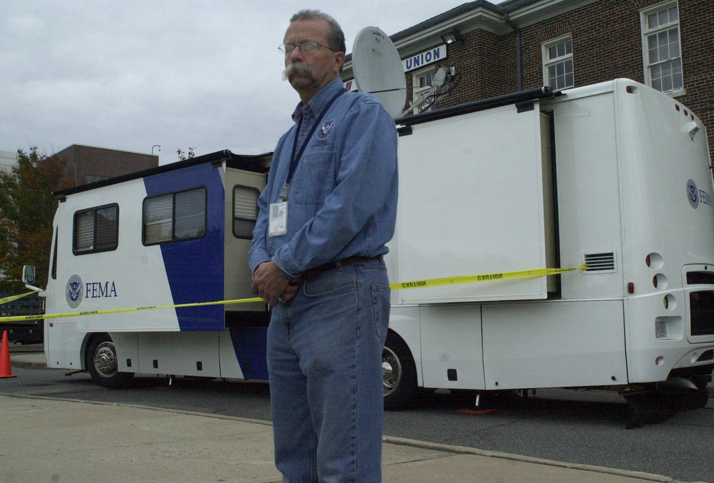 Gary Weidner, a media relations specialist with the Federal Emergency Management Agency, flew in from Nevada to assist in the recovery. Above, he was standing in front of FEMA's mobile Disaster Recovery Center at Nassau Community College's Student Union.