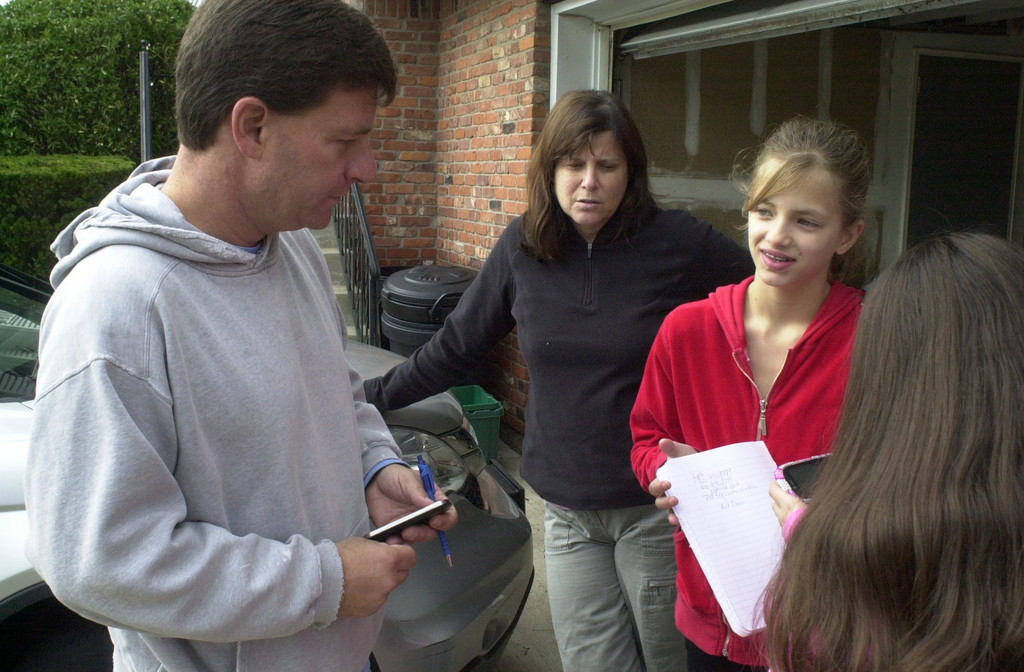 Nassau County Legislator David Denenberg stopped by to check on the Schoenbergs of south Merrick, who, as of Tuesday, had been without power and heat for eight days. Ilissa Schoenberg, center, said she was happy to send her daughter Gabrielle to school on Tuesday to get warm.