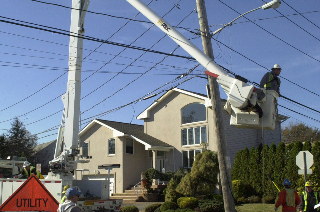 On Tuesday, a crew worked to repair a downed line on George Court in south Merrick, where a series of trees fell in Hurricane Sandy.