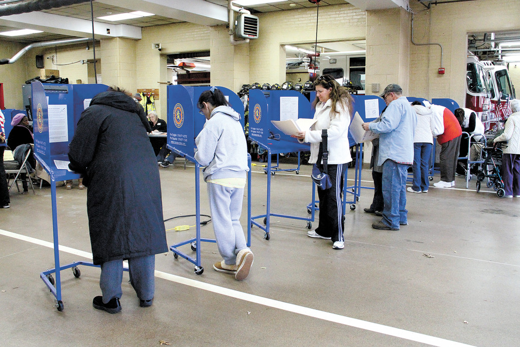 Voters occupied the privacy booths to fill out their ballots on Election Day.