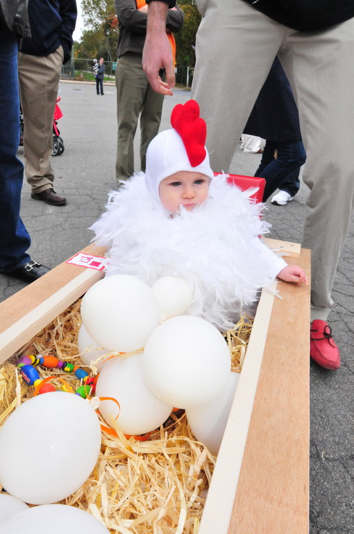 Maeve Quinn, 8, months, was a chicken at the parade.