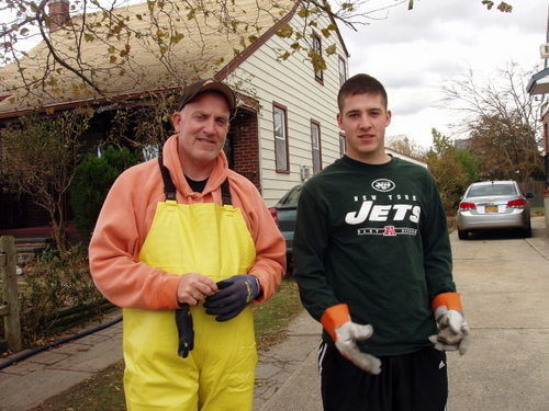 Joe Lores and his son, Mike, helped family pump out their basement on Rhame Avenue