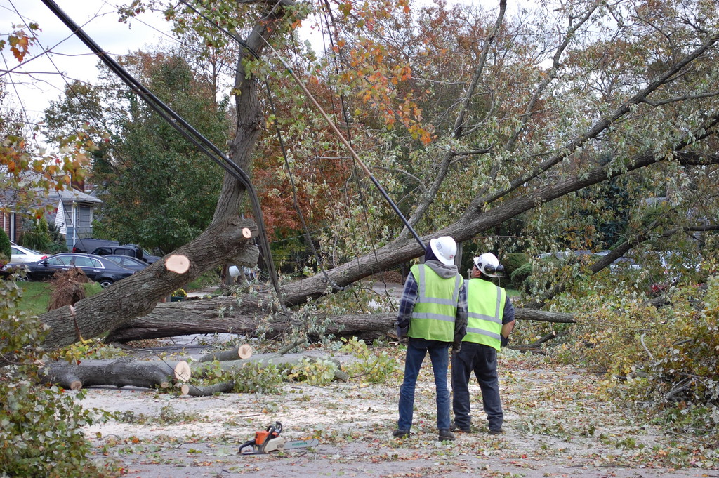 LIPA workers examine the damage on White Street in the northeast corner of Valley Stream.
