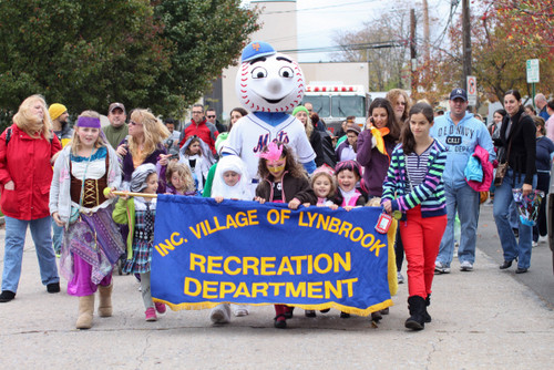 A parade of children and adults made its way down St. James Place.