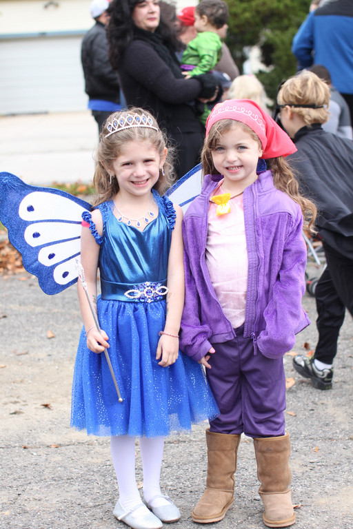 Rachel Stein (left) and Rebecca Murphy, both 5, dressed up in costume and awaiting the start of the parade.