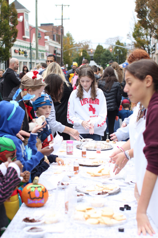 Lauren Cleary, 12, made Halloween cookies along with lots of other children.  A La Carte provided the ingredients and members of the Lynbrook High School Leadership/Key Club helped run the table.