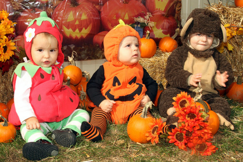 three cuties: In East Rockaway, Gracie Dillard, 1, Joseph Giordano, 8 months, and Brody Marasco, 1, came dressed as a strawberry, a pumpkin and a clapping monkey.