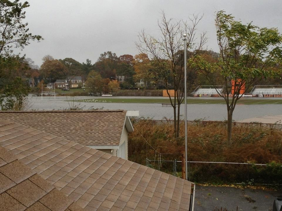 During the storm, water filled the football field behind East Rockaway High School and headed toward the school itself.