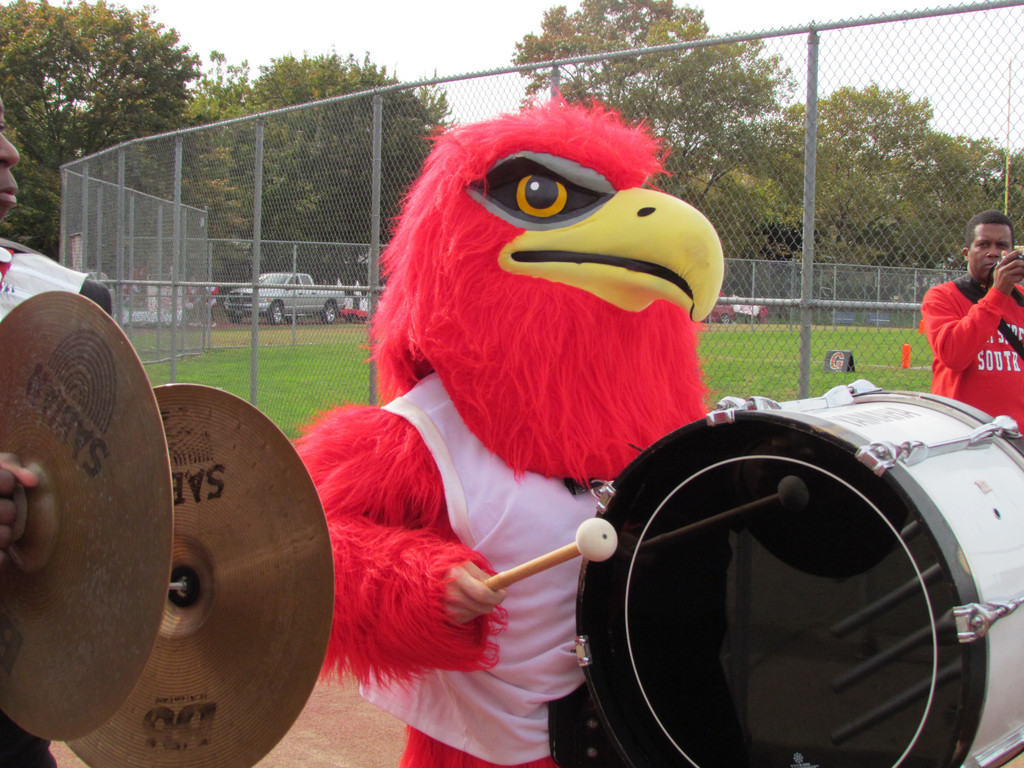 Falco, South's mascot, got into the spirit of things playing the drums during the Homecoming parade.