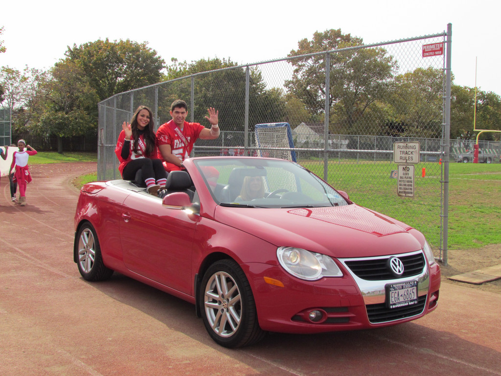 Homecoming King and Queen, Anthony Stallone and Breanna Romero, rode around the track in a convertible.