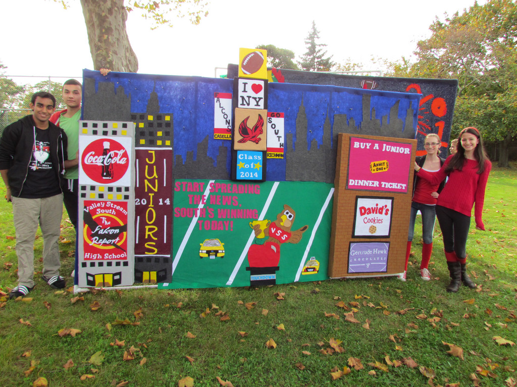Shery Waheed, 16, Christian Failla, 16, Nicole Quaranto, 16 and Dawn Lupeke, 16 displayed the winning banner designed by the Class of 2014. The class has won the banner contest for the past five years at Homecoming.