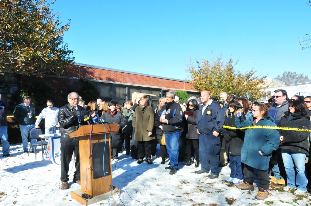 Superintendent Dr. Herb Brown addresses a crowd in front of Oceanside School 8 Friday morning.
