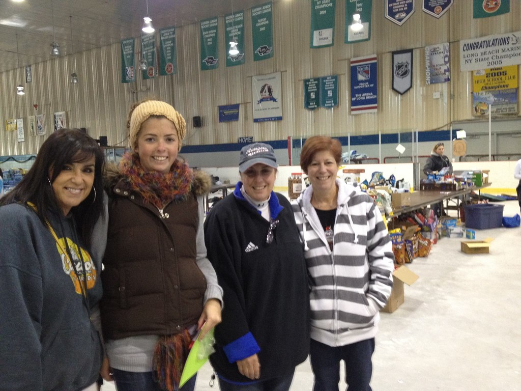Volunteers Francine Harwood, far left, Gillian Bella, Pamela Darling and Cheryl Levy helped out at the ice arena last Tuesday.