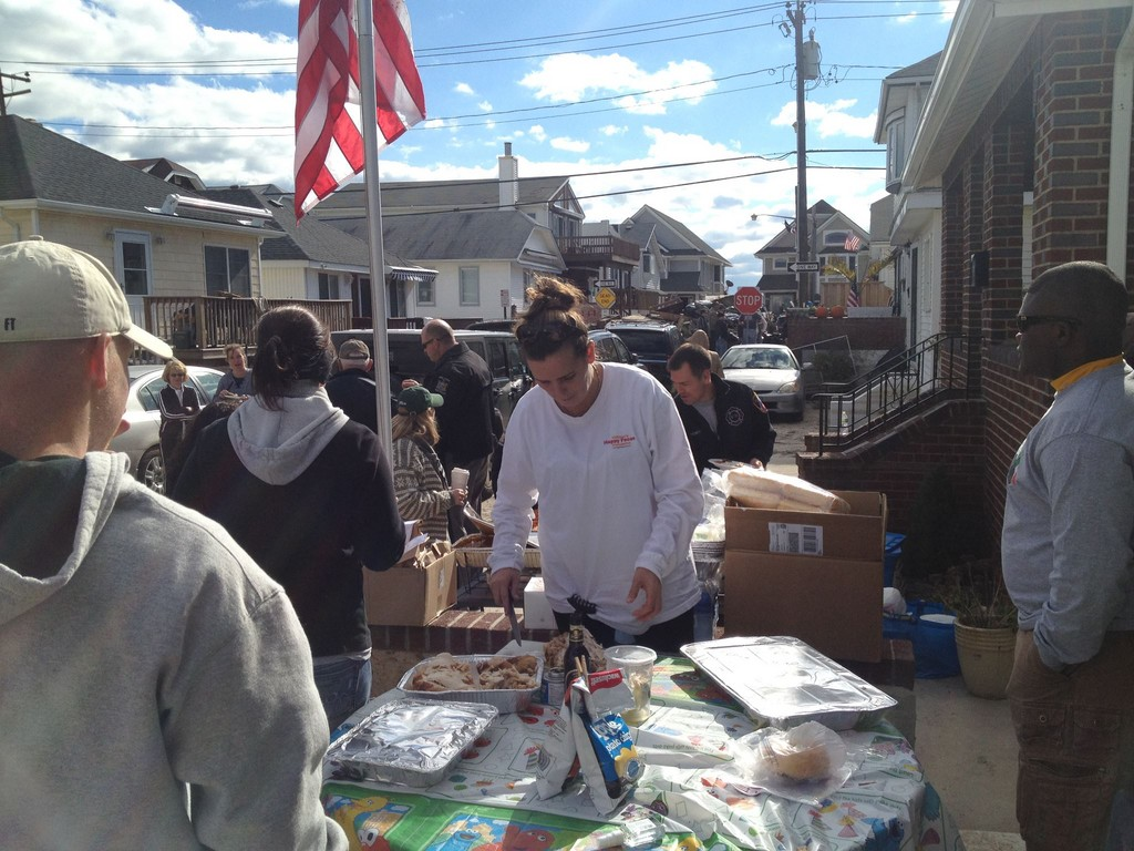 On Louisiana Street, Bernadette Riordan brought hot meals to people clearing debris last Saturday.