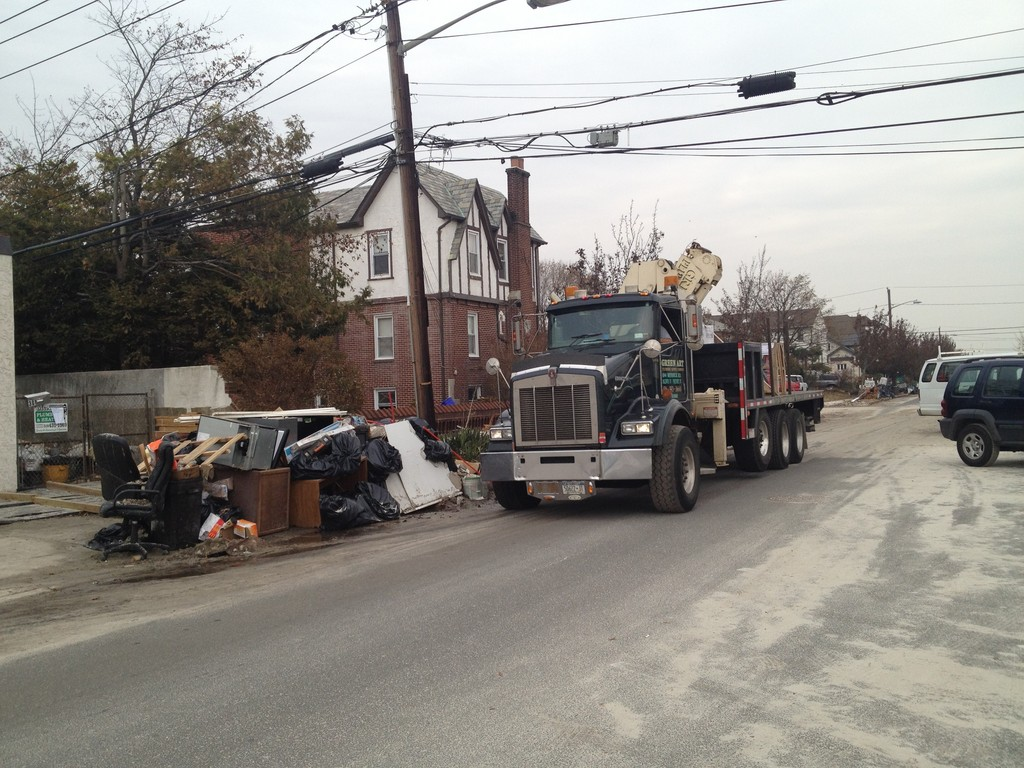 Trash was piled near the corner of Laurelton Boulevard and West Broadway on Saturday.