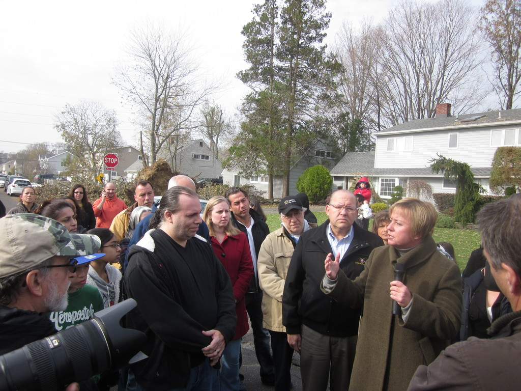Town of Hempstead Supervisor, joined to her right by Councilman Gary Hudes, gathered with residents in Levittown to criticize LIPA's slow response, and to demand more attention to the area.