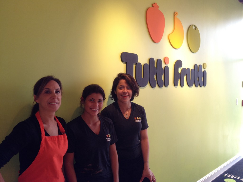 Tutti Frutti employees Sahri Shapiro, left, Dana Vargas and Jenn Banegas returned to work on Friday.