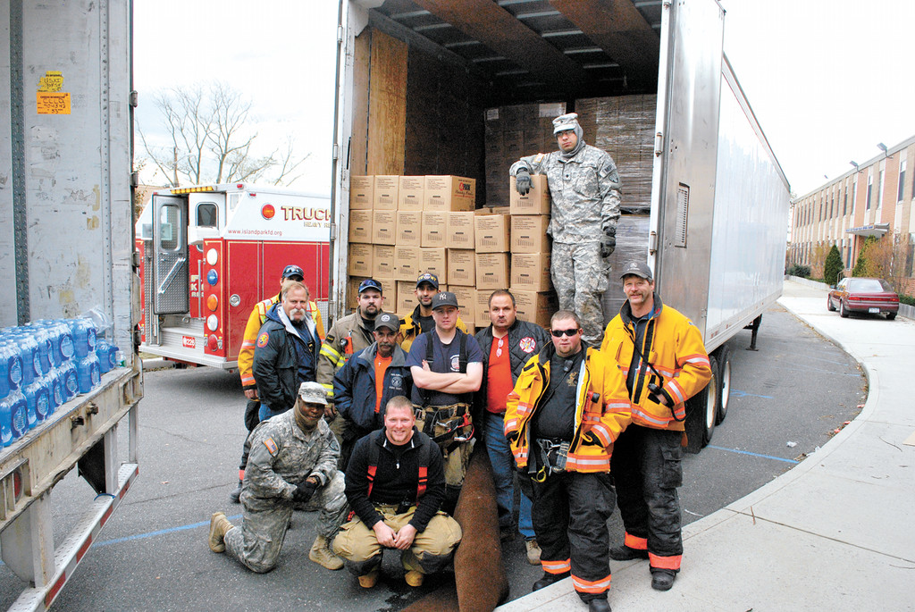 Fire fighters from upstate worked with the National Guard to offload supplies at Lincoln Orens Middle School in Island Park.