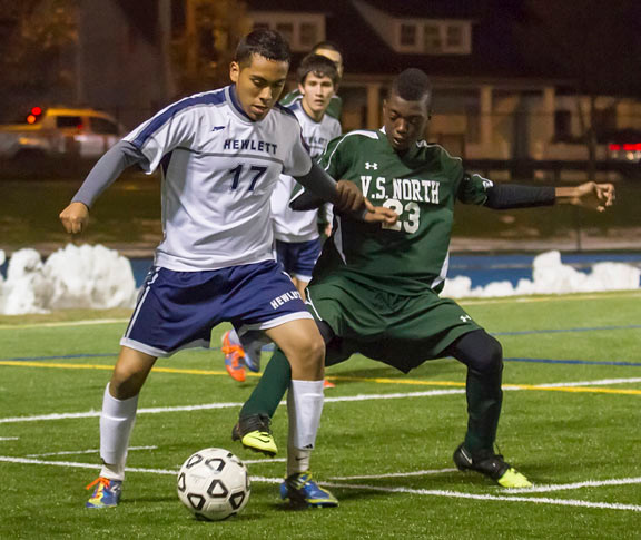 Hewlett's Kelvin Larios, left, battled Valley Stream North's Evan Peters for control during last Friday's Nassau Class A quarterfinal playoff game.