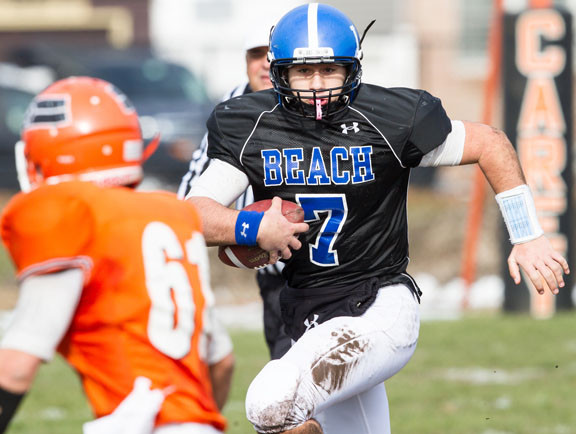 Long Beach quarterback Adam Salvadori charged upfield during last Saturday's Nassau Conference II playoff defeat at Carey.