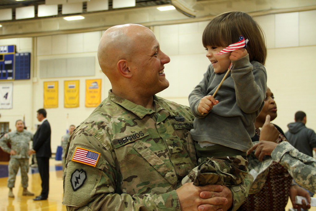 Sgt. Robert Berrios and his son Bruce were all smiles as they greeted each other.