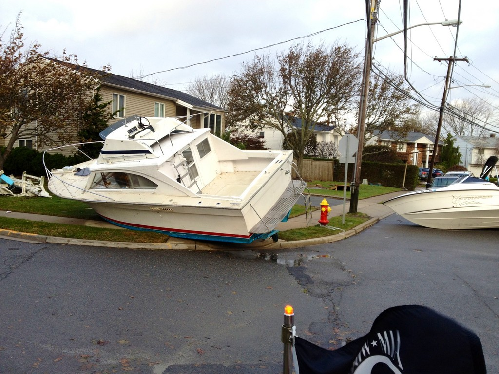 Among the Fire Department's duties in the wake of the storm was removing boats that floodwaters sent onto south Merrick streets, including these on Hewlett Avenue.