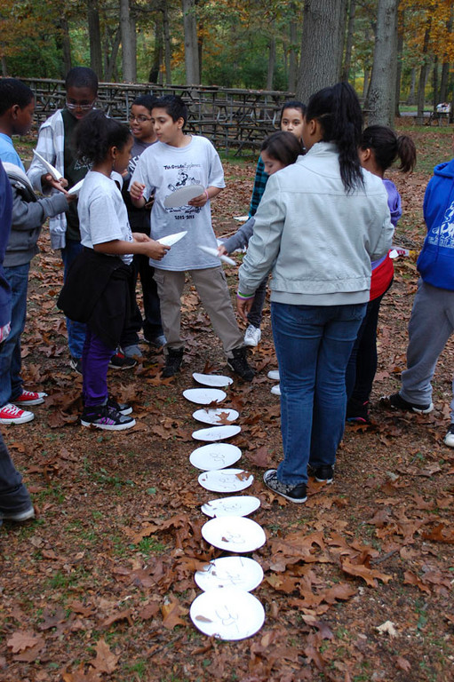 Students work together to create a number line in Key Punch at Valley Stream State Park on Oct. 26.