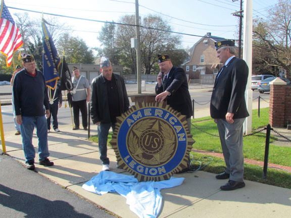 American Legion Andrew Fatscher Post 854 of Valley Stream hosted its annual Veterans Day service last Sunday morning. As part of the ceremony, Joe Leone, a member of The Sons of the American Legion, presented the refurbished American Legion seal to Post Commander John Faust, second from right.