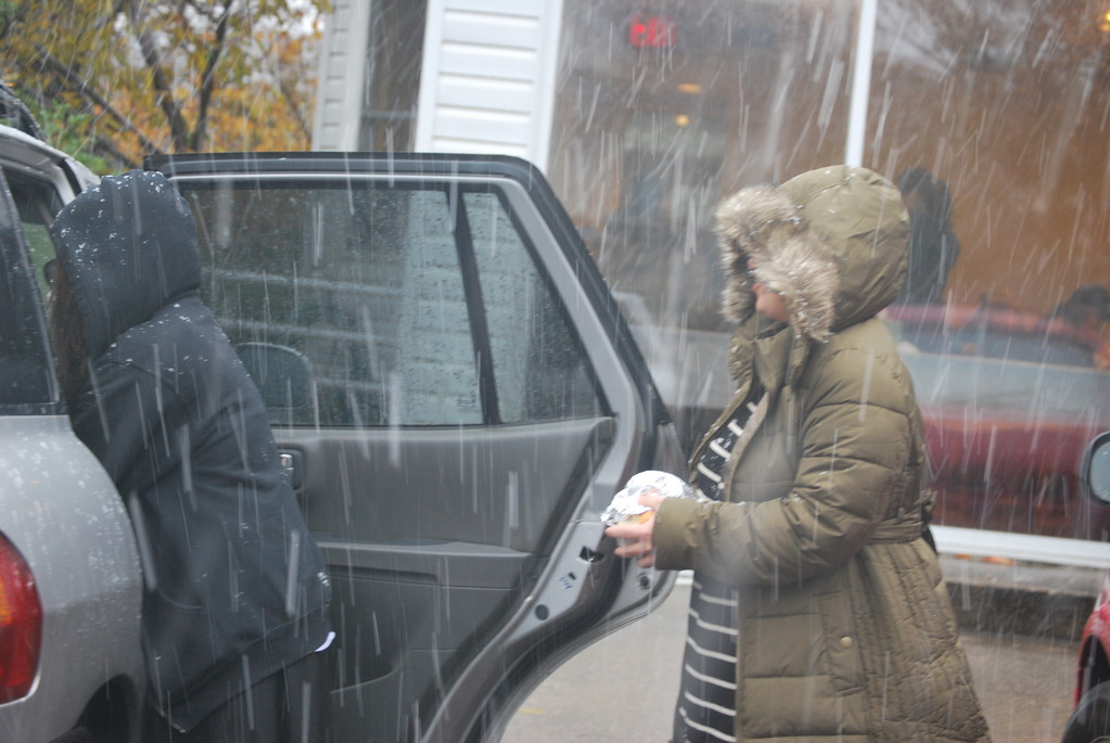Chabad of the Five Towns has assisted nearly 2,000 people in the weeks after Hurricane Sandy. Torah Academy for Girls student Gitti Apperman, left, helped put food in a vehicle as it snowed on Nov. 7.